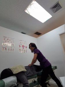 Dr. Natalie adjusts a patient spine and pelvis