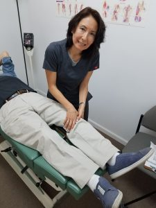 Dr Natalie adjusts the knee