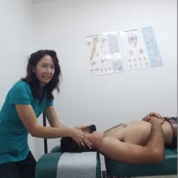 Dr. Natalie adjusts the neck