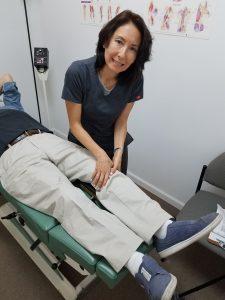 Dr. Natalie Meiri adjusts the knee