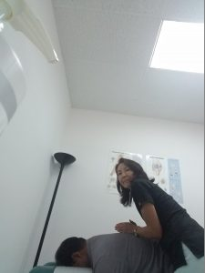 Dr, Meiri adjusts a patient